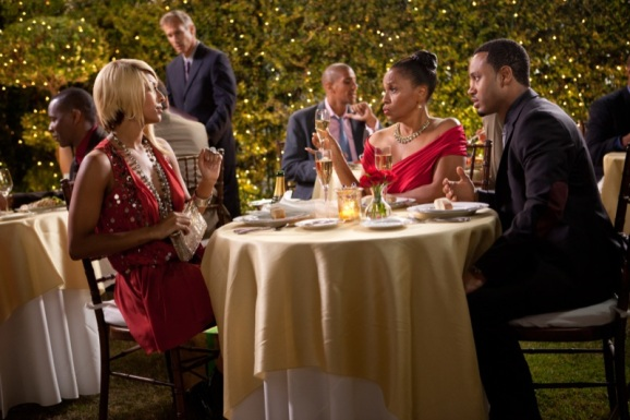 Michael's date, Heather (Keri Hilson, left) with Loretta (Jenifer Lewis, center right) and Michael (Terrence J, right) in Screen Gems' THINK LIKE A MAN.